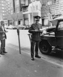 Policeman booking a car by Greg Weight