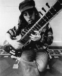 Sam Bienstock playing a sitar by Greg Weight